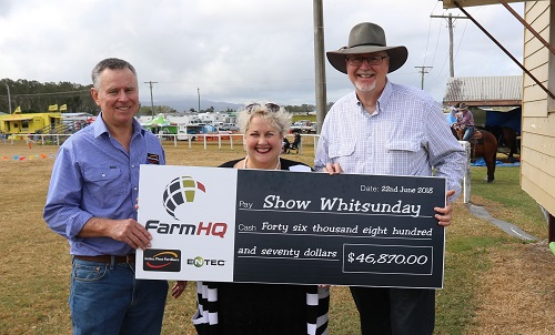 Noel Matthews, Incitec Pivot Fertilisers (left) and Donna Rogers, Farm HQ, present the cheque to Mike Porter, Vice-President of the Proserpine Showgrounds Committee, to help rebuild the Proserpine show pavilion